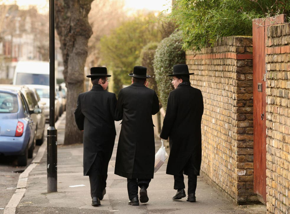 Jewish men walk along the street in the Stamford Hill area of north London on January 19, 2011 in London, England. The residents of Stamford Hill are predominately Hasidic Jewish and only New York has a larger community of Hasidic Jews outside Israel.