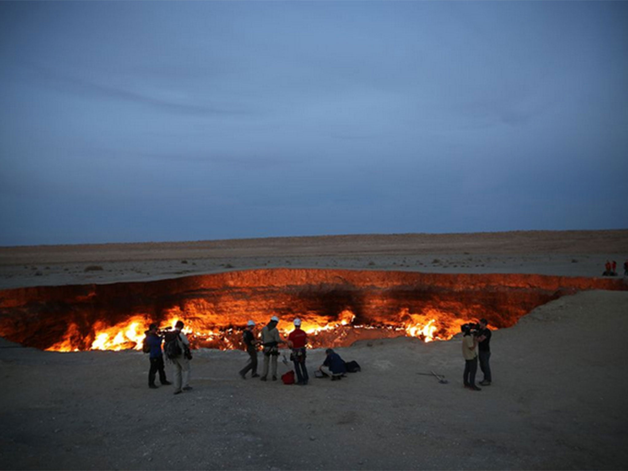 Door To Hell Man Dangles Himself Over Molten Gas
