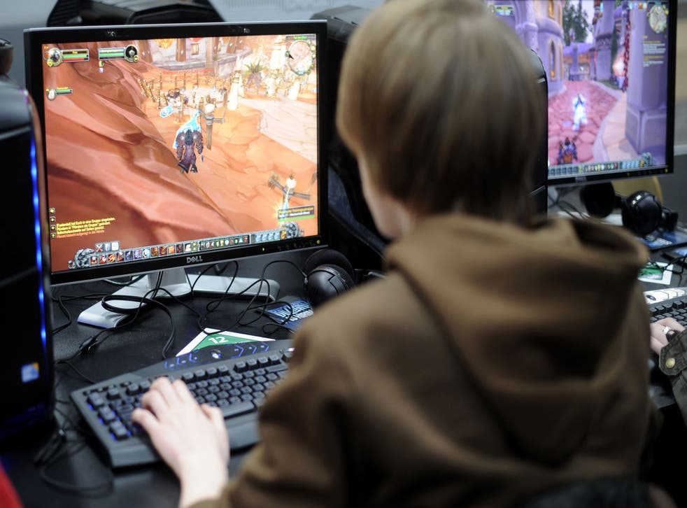 A young man plays the computer game 'World of Warcraft'