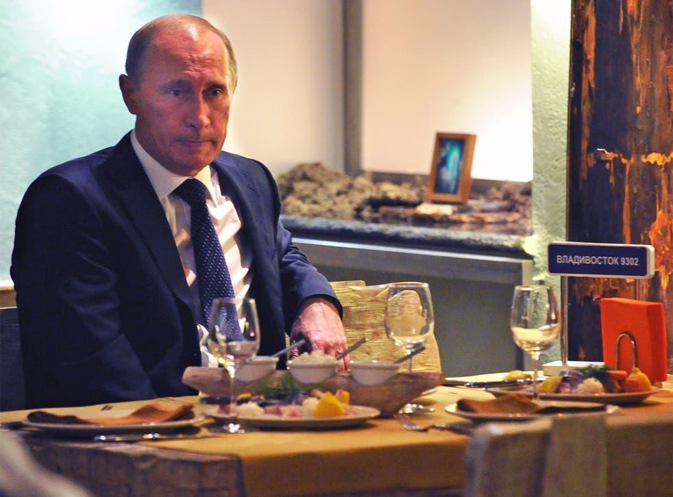 Very tasty: Vladimir Putin dining alone, perhaps sensibly