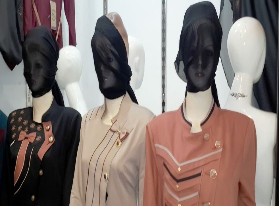 In this Monday, July 21, 2014 photo, mannequins with their faces covered are displayed in a shop window in central Mosul, 225 miles (360 kilometers) northwest of Baghdad, Iraq. The Islamic State group ordered clothes shop owners to cover the faces of the