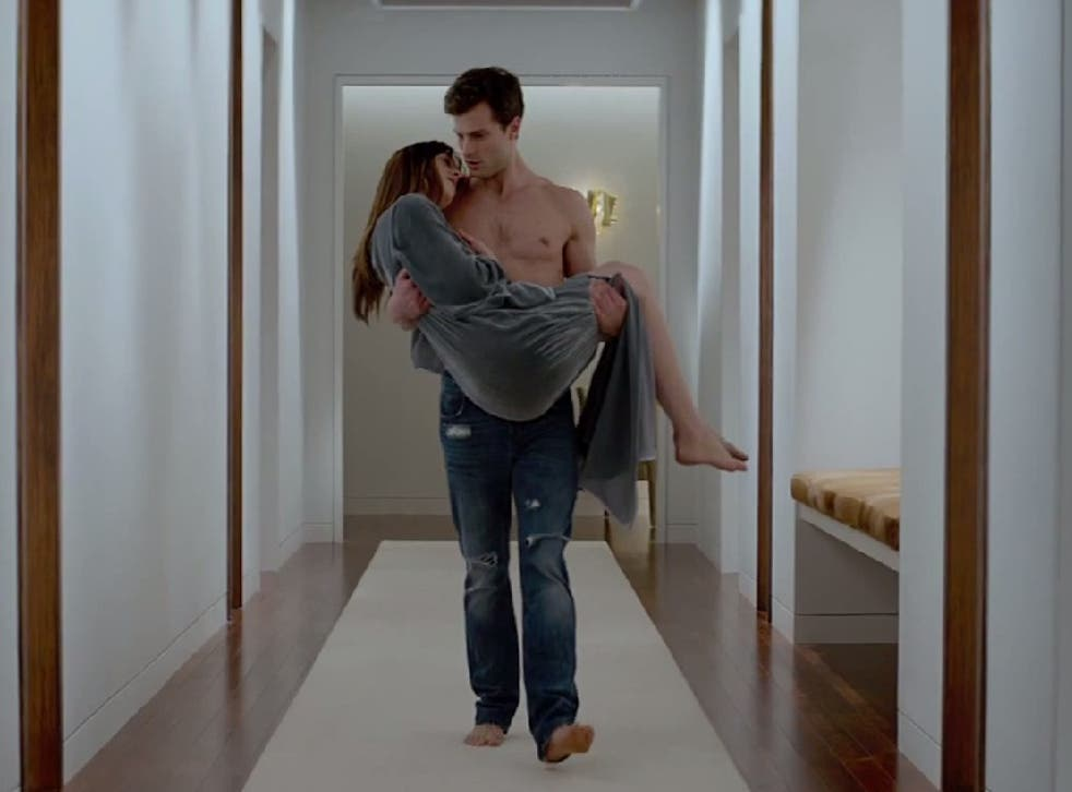 Christian Grey cradles Ana in the Fifty Shades of Grey film