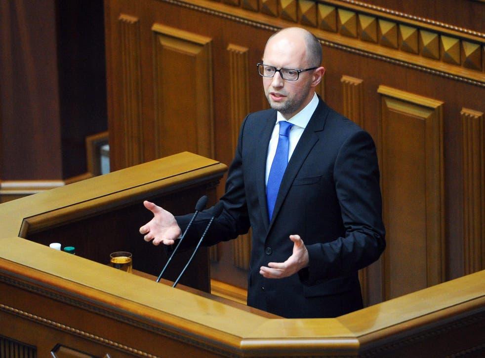 Ukrainian Prime Minister Arseny Yatseniuk addresses the parliament in Kiev, Ukraine