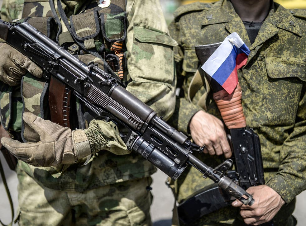 A pro-Russia separatist with a Russian national flag attached on his uniform. The US said on Thursday it has 'new evidence' Russia has been firing artillery from within its territory into Ukraine.