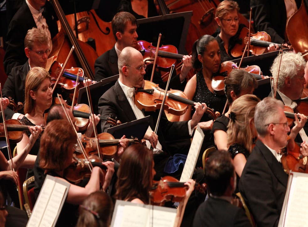 The string sections plays during the first night of the Proms, 2014