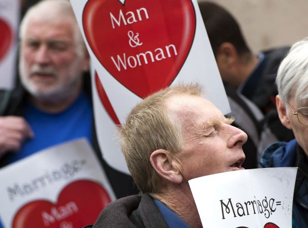 Anti-gay marriage protesters outside  Parliament on 21 May 2013