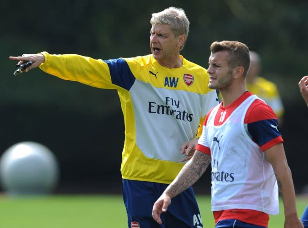 Follow my leader: Jack Wilshere listens to manager Arsène Wenger