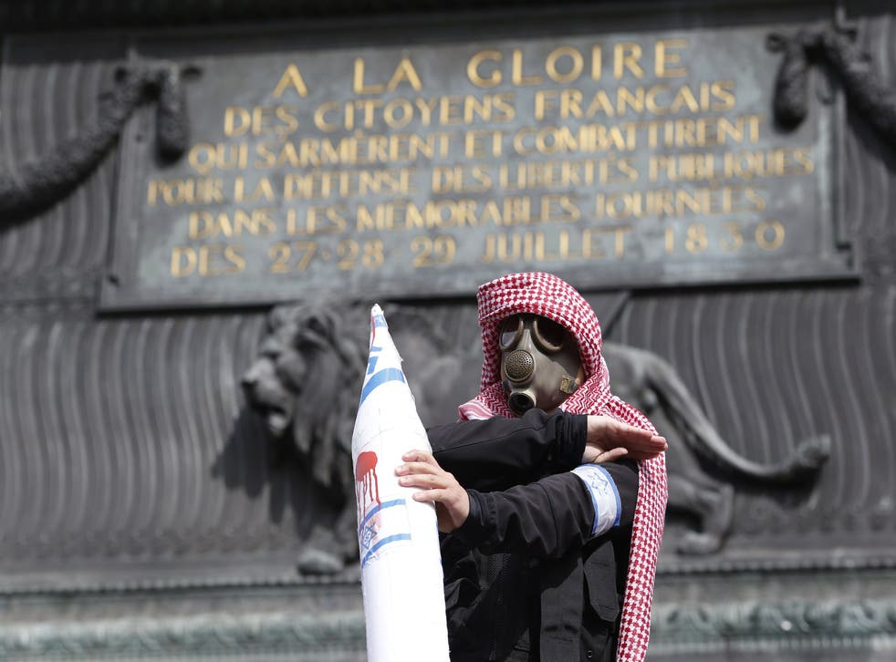 The quenelle gesture, widely seen as anti-Semitic, given in France