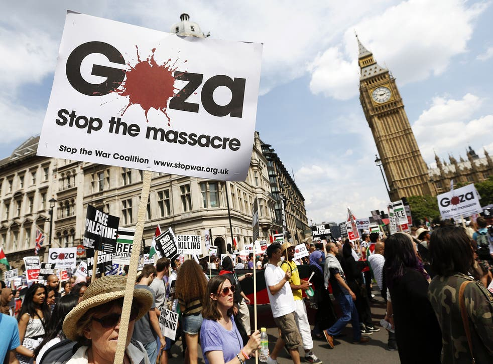 Demonstrators march through the streets from outside the Israeli embassy in central London on July 26, 2014, calling for an end to violence in Gaza.