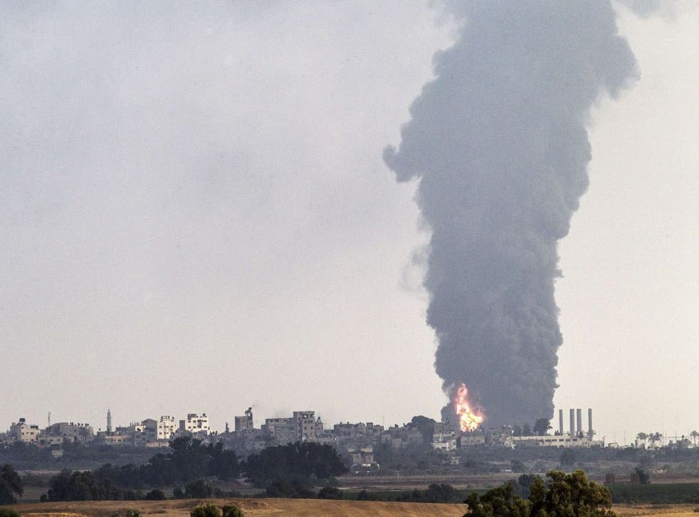 A picture taken from the southern Israeli Gaza border shows smoke billowing from a power plant in the coastal Palestinian enclave following an Israeli air strike