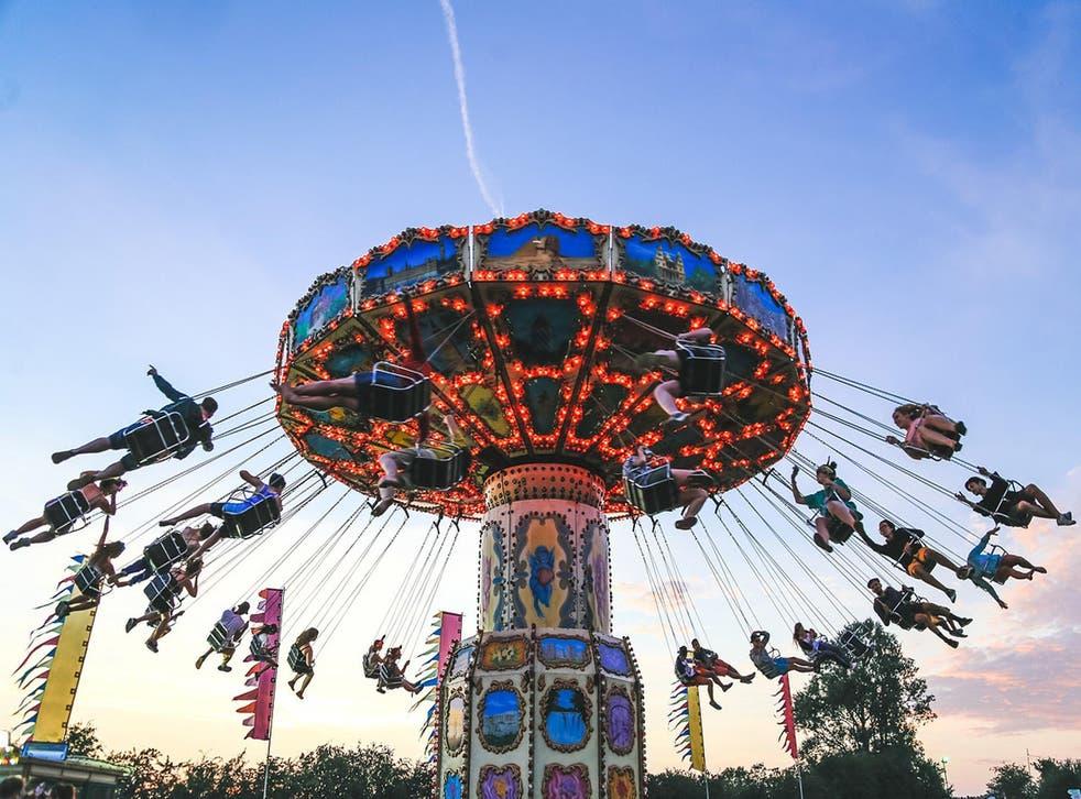 Festival-goers enjoy a fairground ride at Secret Garden Party 2014