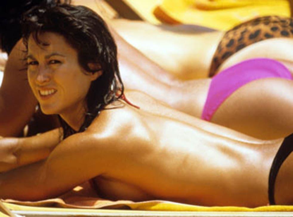 Topless sunbathing