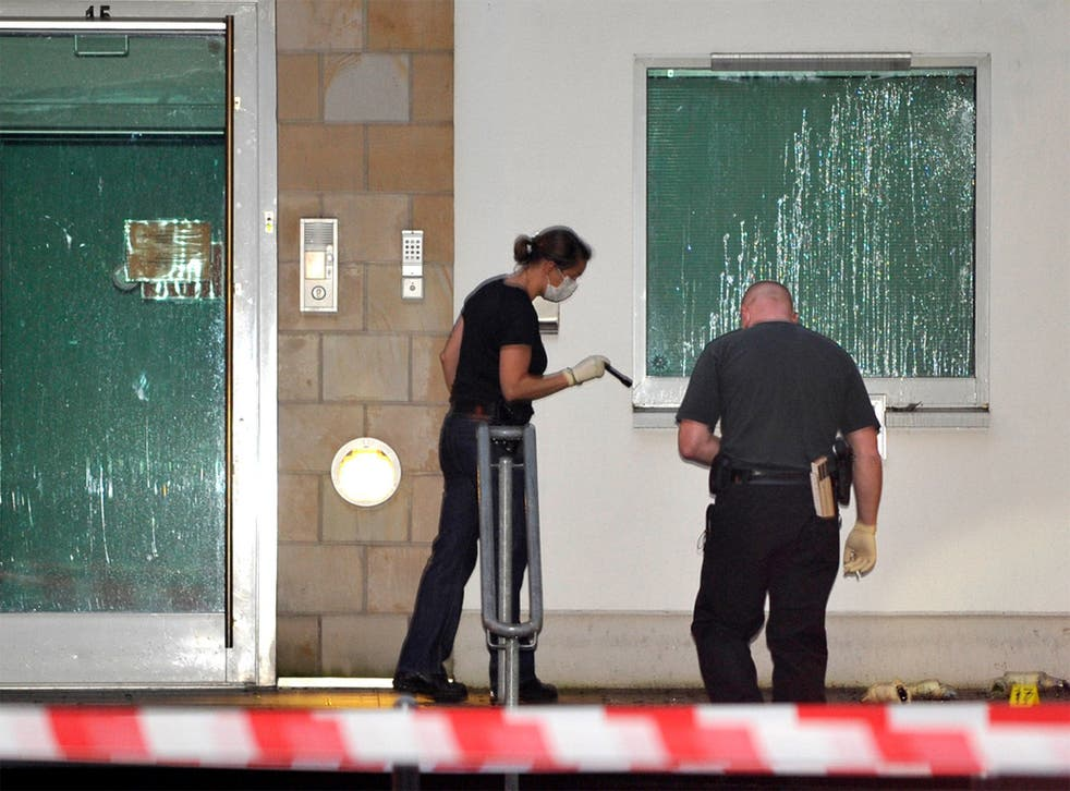Police search for evidence in front of the synagogue in Wuppertal, Germany