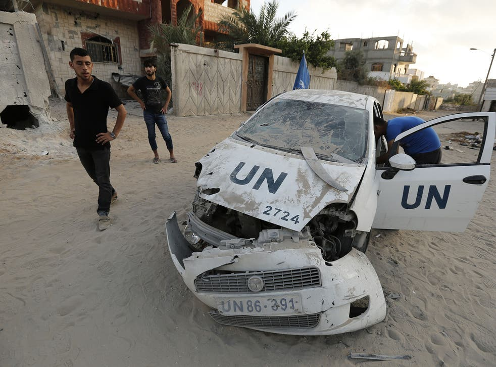 A destroyed UN vehicle is seen in Beit Lahia in the northern Gaza Strip on July 29, 2014 following Israeli military strikes.