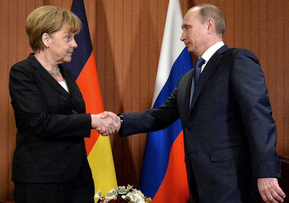 Land for gas merkel and putin discussed secret deal could end russian president vladimir putin shakes hand with german chancellor angela merkel during a meeting last m4hsunfo