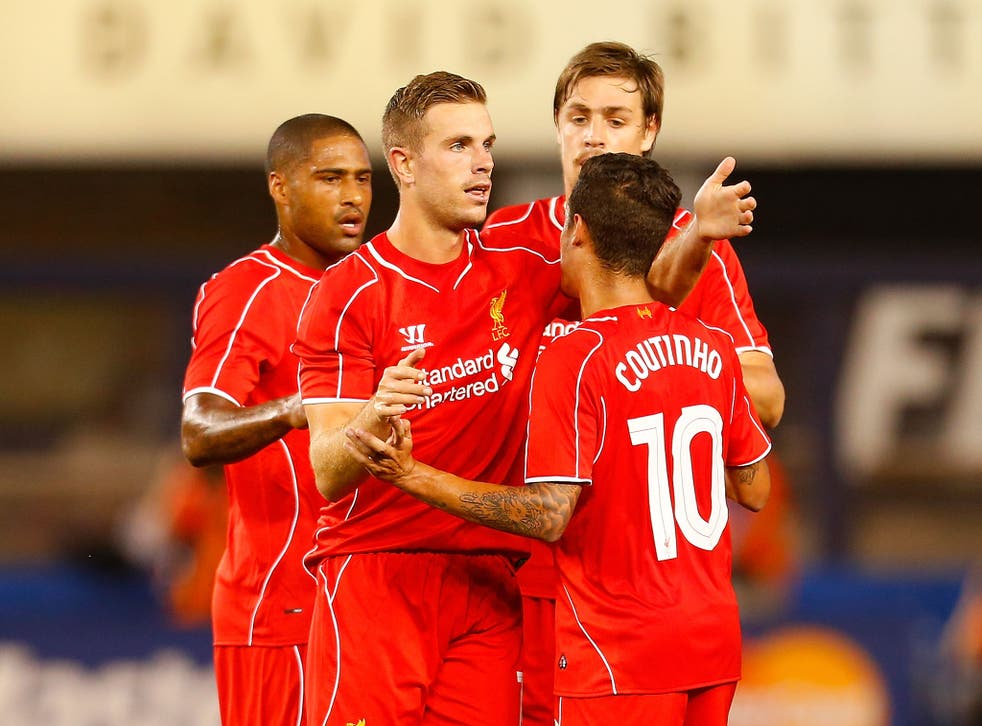 Jordan Henderson celebrates scoring for Liverpool against Manchester City in the International Champions Cup in New York