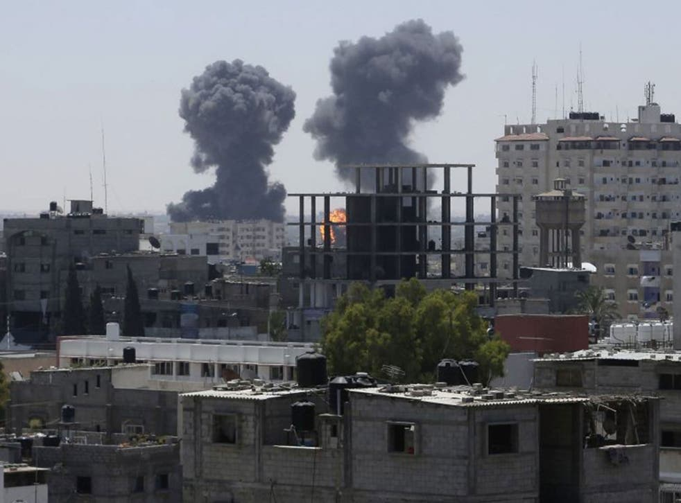 Smoke and flames are seen following what witnesses said were Israeli air strikes in Rafah in the southern Gaza Strip August 1, 2014.