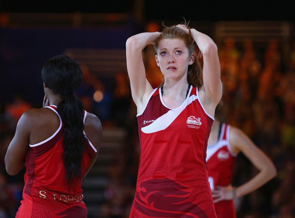 Helen Housby of England is dejected after New Zealand defeated England in the netball semi final