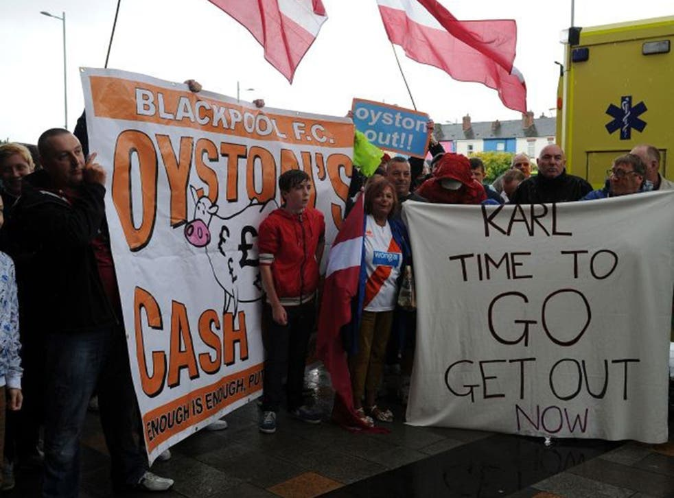 Tangerine nightmare: Fans protest outside Bloomfield Road yesterday