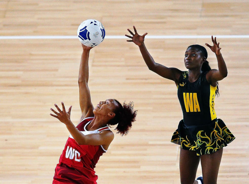 England's Serena Guthrie (above left) and Jamaica's Khadijah Williams compete for the ball in the bronze medal match