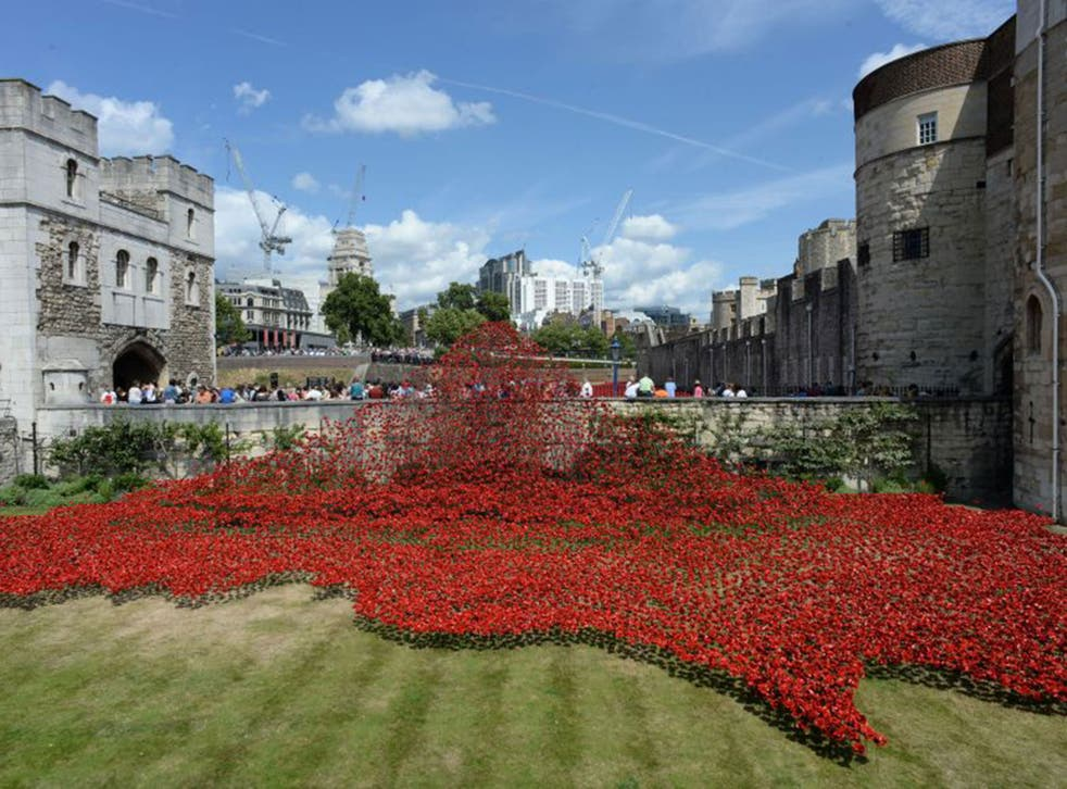 The art installation 'Blood Swept Lands and Seas of Red' by Paul Cummins at the Tower of London