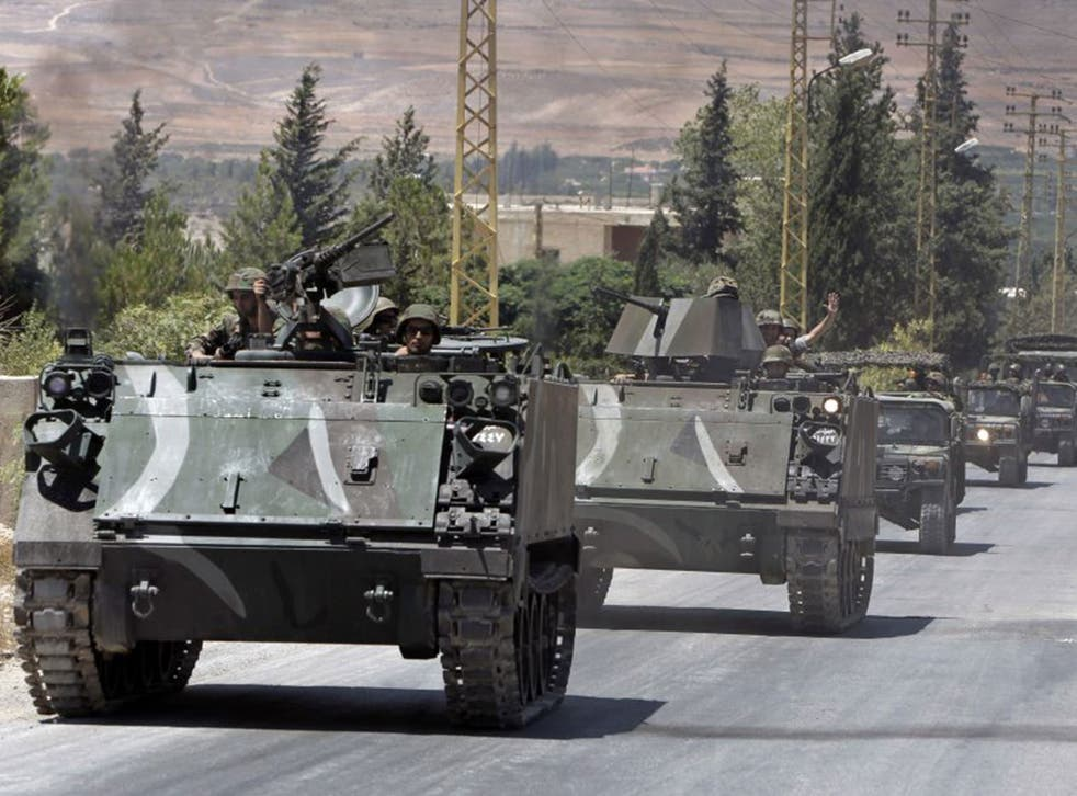 Lebanese army reinforcements arrive in the outskirts of Arsal, a predominantly Sunni Muslim town near the Syrian border in eastern Lebanon, which was overrun by militants
