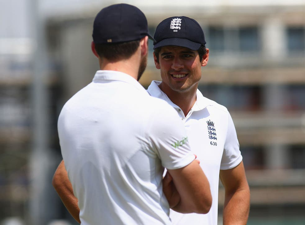 Alastair Cook and Jimmy Anderson speak on the field