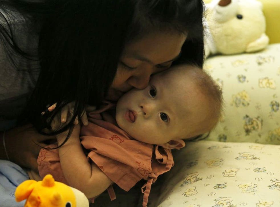 Child protection services in Australia have made contact with a couple accused of leaving a baby with Down's syndrome with its Thai surrogate mother, taking only his healthy twin sister.