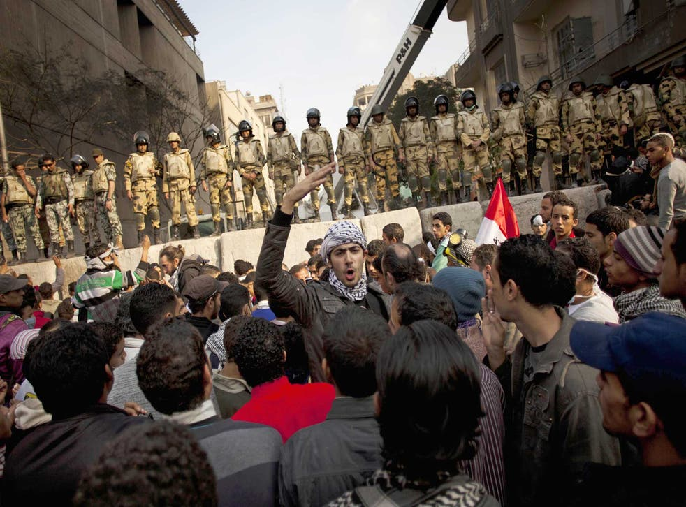 Wrestling with established opinion and their consciences: a stand-off in Tahrir Square, Egypt, 2011
