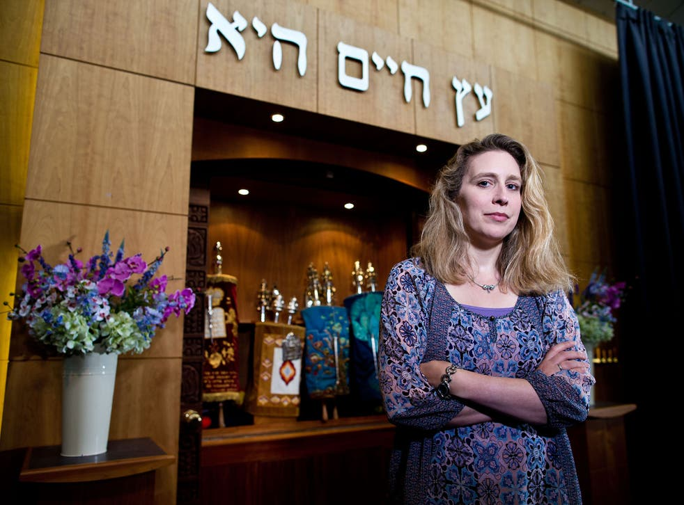 Rabbi Miriam Berger of the Finchley Reform Synagogue, standing in front of the Torah Ark