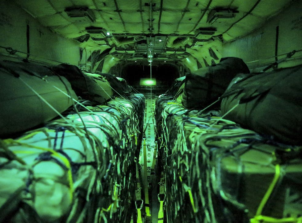 Aid inside a Royal Air Force (RAF) Hercules C130 J aircraft before being airdropped to civilians in Iraq