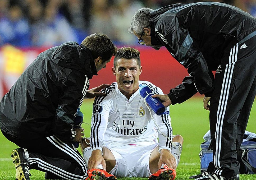 598b78206 Cristiano Ronaldo receives attention from Real Madrid physios during the  Super Cup win over Seville