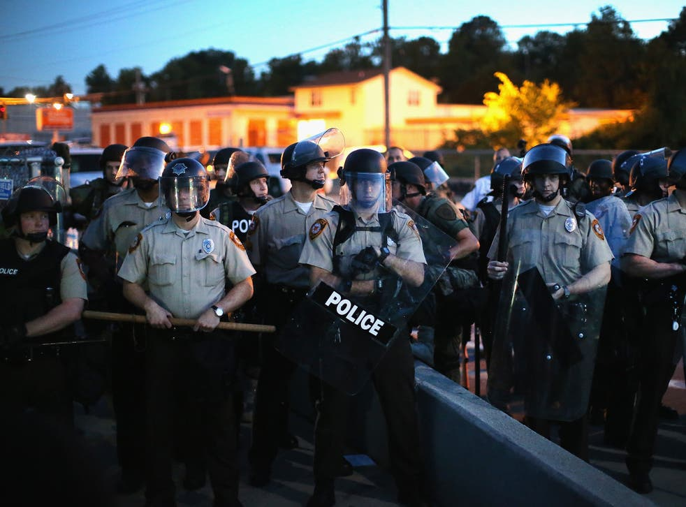 Police stand watch during the demonstrations. These are not the officers referred to in the report below