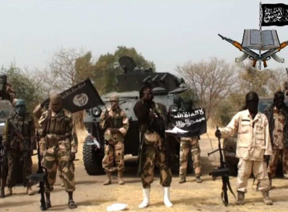 Boko Haram, pictured here in a still from one of their previous videos, have reportedly freed 27 hostages in Cameroon