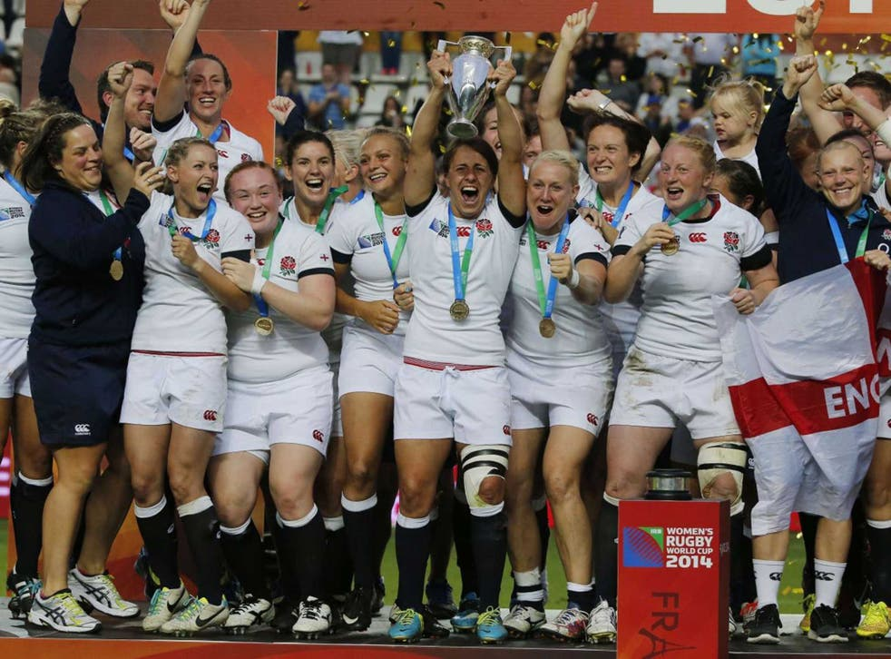 The England captain Katy Mclean lifts the World Cup trophy after her side's win over Canada in the final in Paris