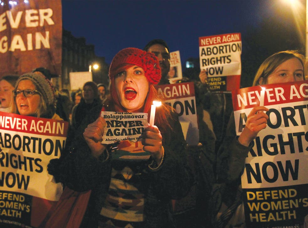 Protesters march to the Irish Parliament in memory of Indian Savita Halappanavar in Dublin, November 2012