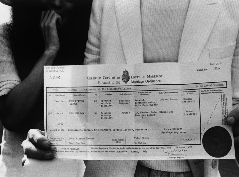 John Lennon and Yoko Ono with their marriage certificate after their wedding on 20th March 1969