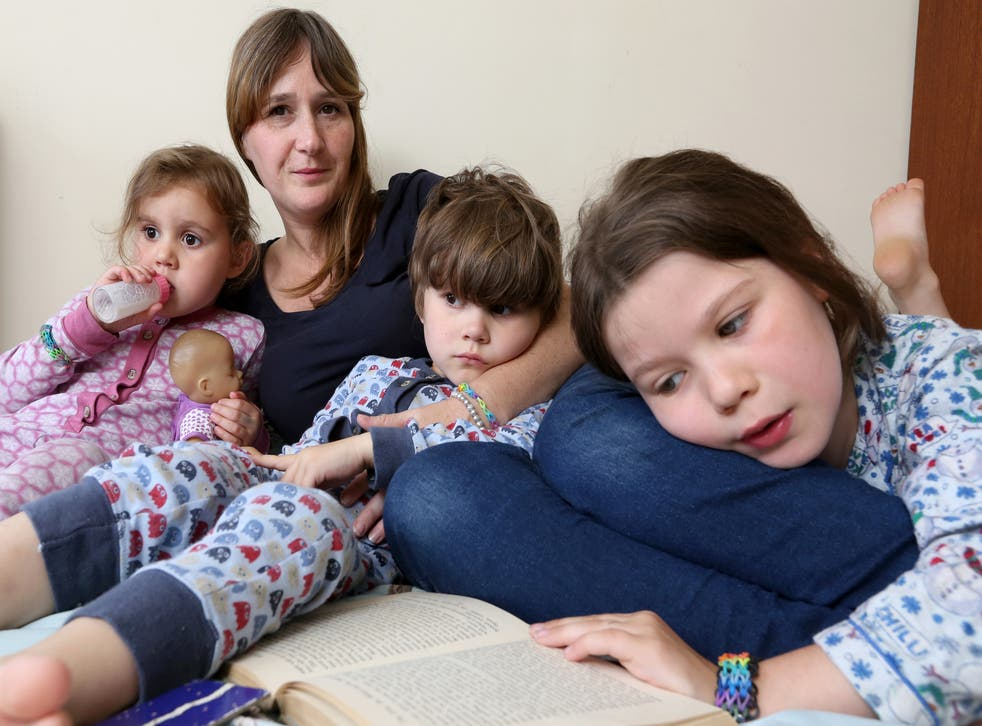 Journalist Rebecca Hardy with her three children, all of whom have shared a bed with her at some point in their lives.