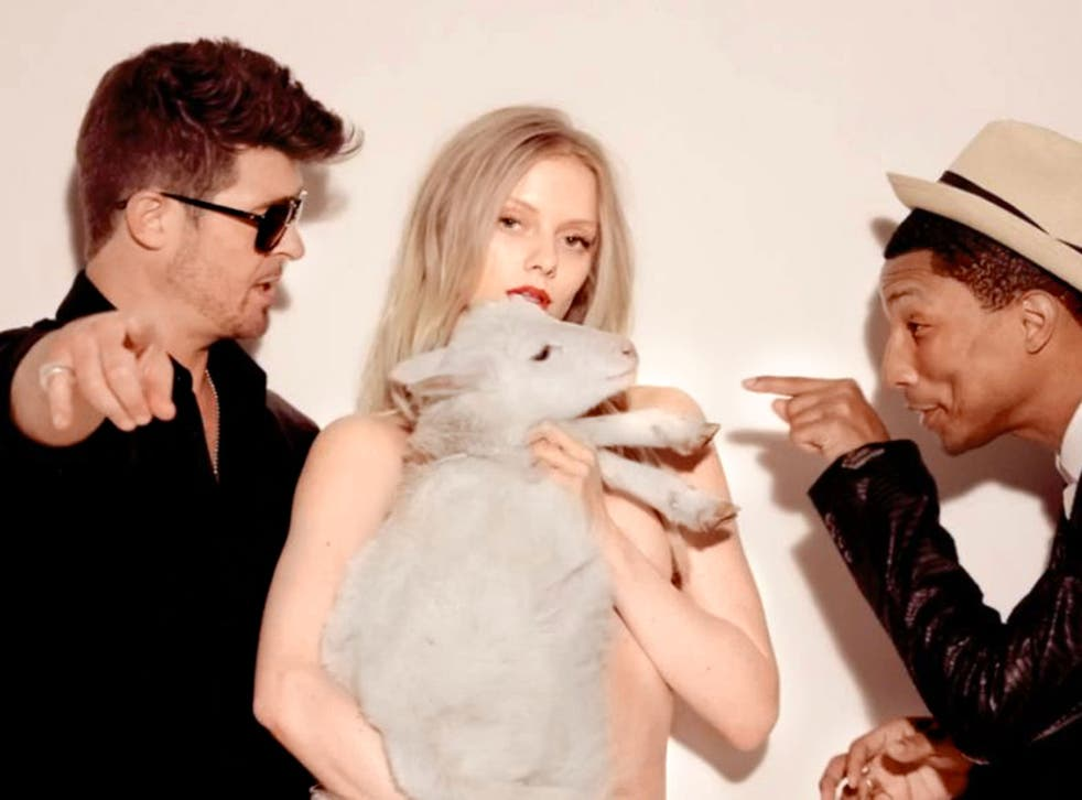 "The highly controversial video to Robin Thicke's ""Blurred Lines"" features multiple nude female models"