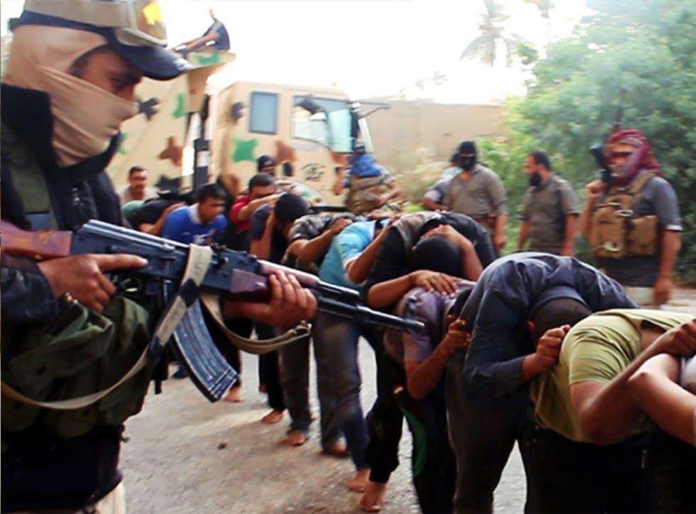 Jihadist militants leading away captured Iraqi soldiers in Tikrit, Iraq, in June