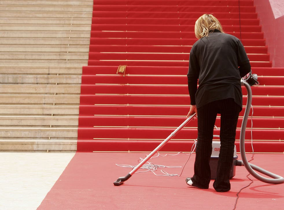 A cleaner prepares the red carpet for the opening night during the 59th International Cannes Film Festival May 17, 2006 in Cannes, France.