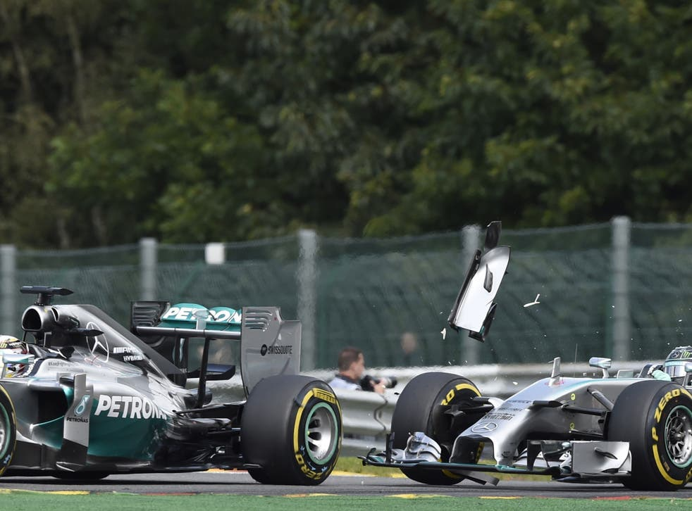 Mercedes-AMG's British driver Lewis Hamilton (L) and and Mercedes-AMG's German driver Nico Rosberg collide at the Spa-Francorchamps ciruit
