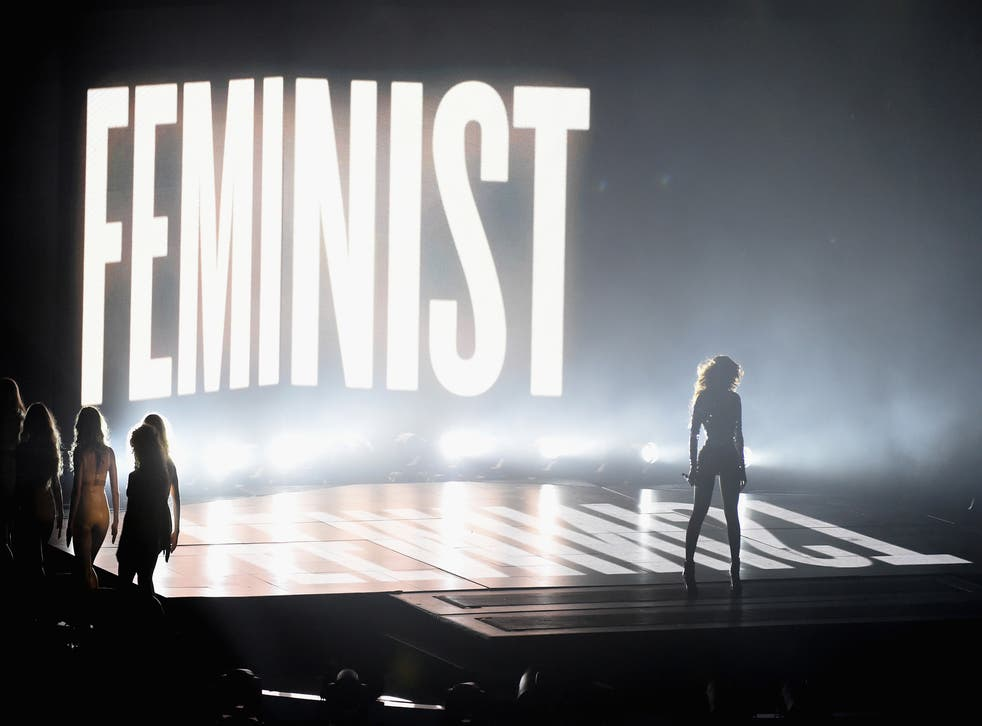 Beyonce performs in front of a Feminist sign at the MTV VMAs 2014