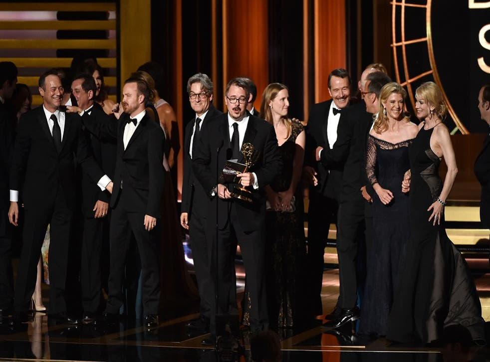 The Breaking Bad cast gather behind creator Vince Gilligan to accept the outstanding drama series prize