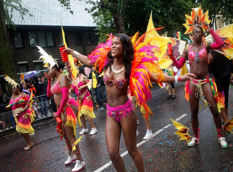 Performers dance through heavy rain during the Notting Hill Carnival in London. Despite the bad weather over 1 million visitors are expected to attend the two-day event which is the largest of its kind in Europe