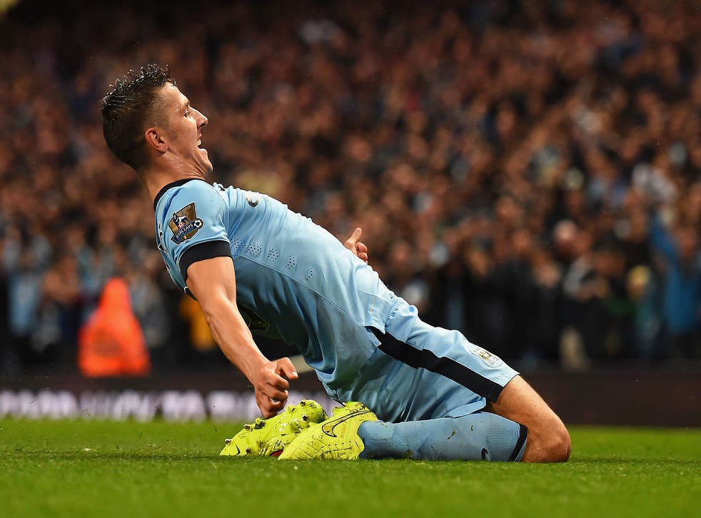 Stevan Jovetic of Manchester City celebrates scoring the opening goal during the Barclays Premier League match between Manchester City and Liverpool at the Etihad Stadium in Manchester, England
