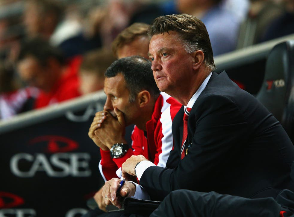 Louis van Gaal (right) and Ryan Giggs look on from the touchline during the 4-0 MK Dons defeat