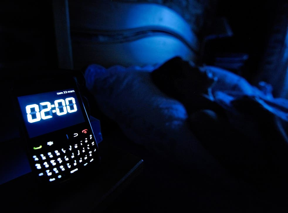 80 per cent of us keep our phones on overnight, with 50 per cent using them as an alarm clock