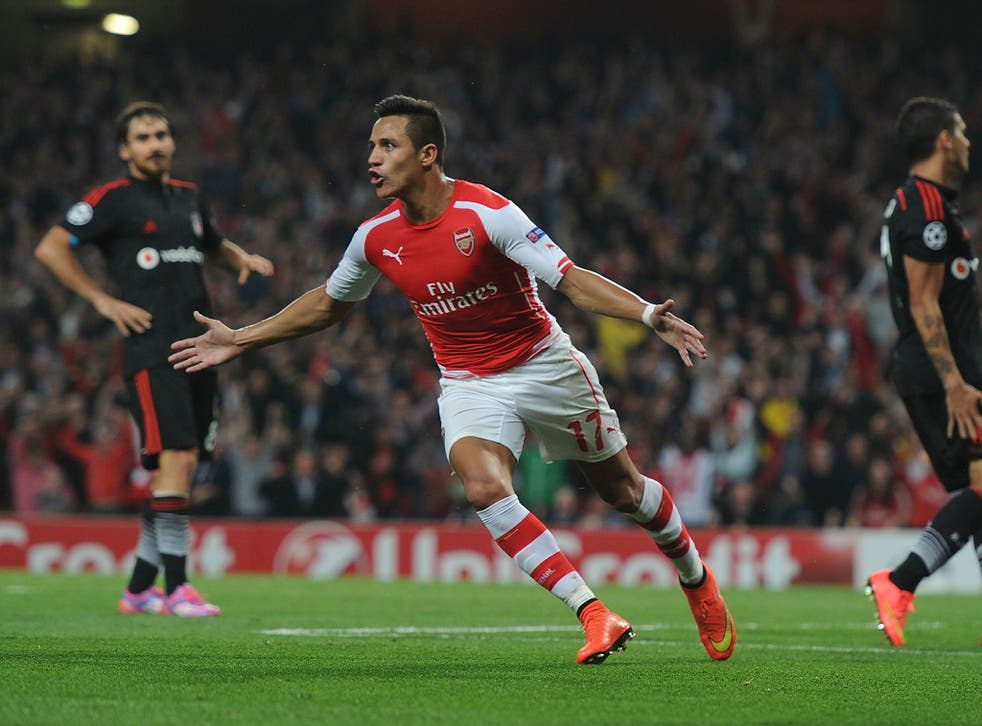 Alexis Sanchez celebrates after scoring his first goal for Arsenal in the Champions League qualifier against Besiktas