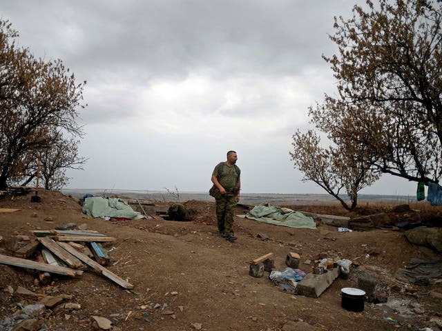 Pro-Russian fighters dig trenches in Troitsko-Khartsyzk, 30km east of Donetsk yesterday amid bombardments from Ukrainian government forces in the eastern region